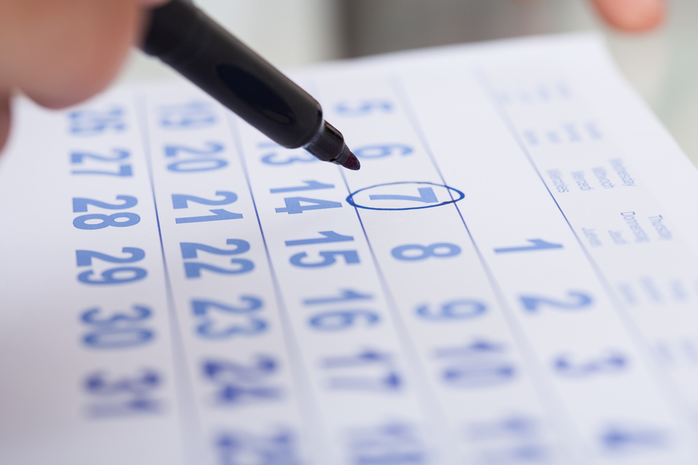 Businessman-marking-date-on-paper-calendar-SS-Andrey_Popov