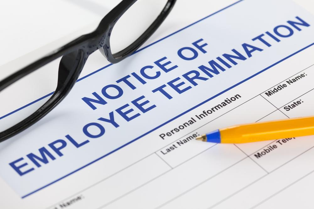 Notice-of-employee-termination-with-glasses-and-ballpoint-pen-SS-Ekaterina_Minaeva