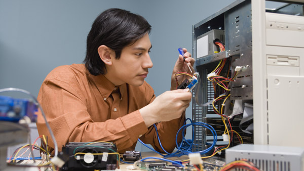 computer repairman working on hard drive