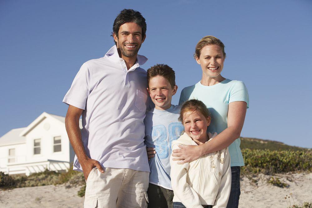 family at vacation beach house