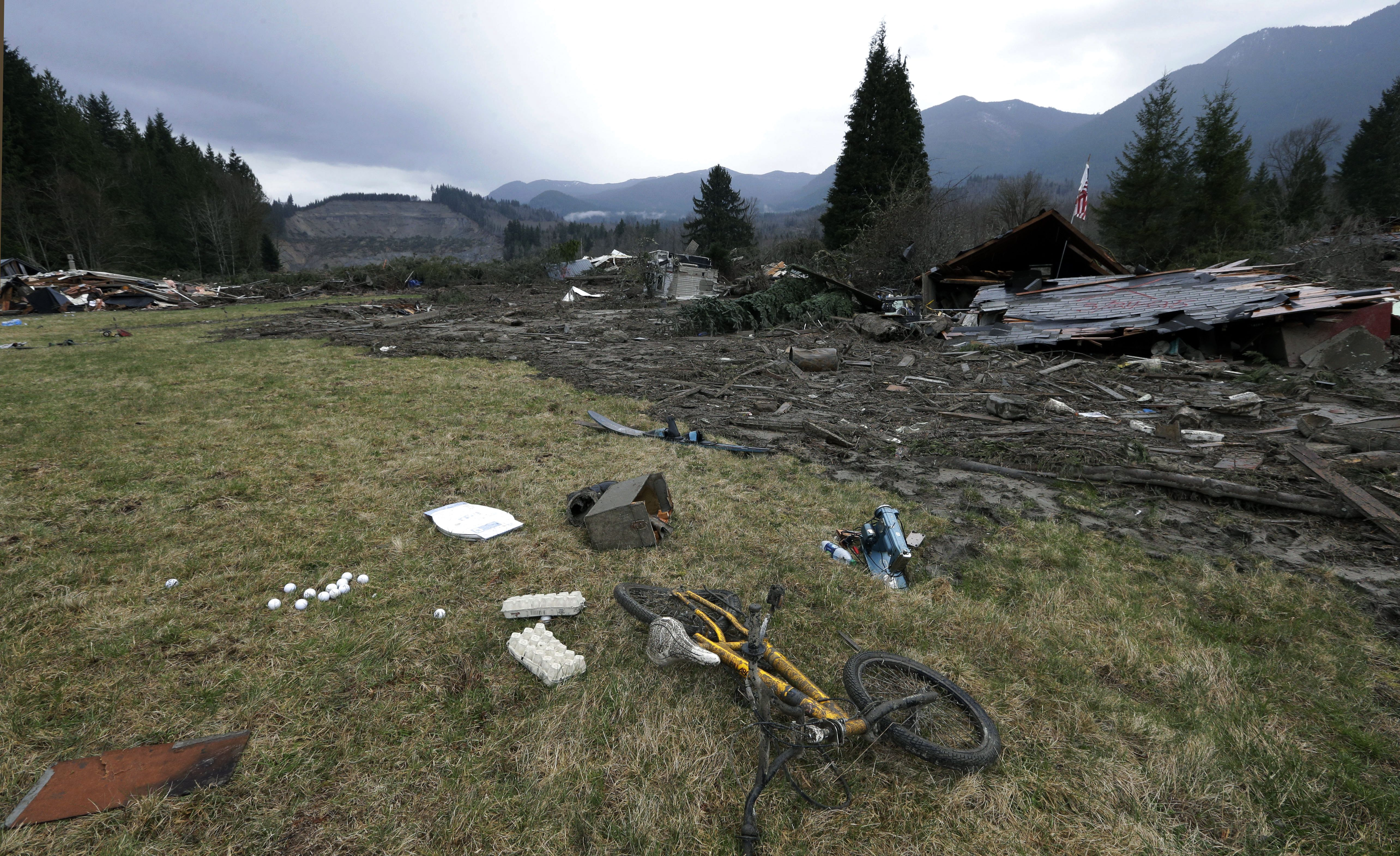 child's bicycle at scene of deadly mudslide