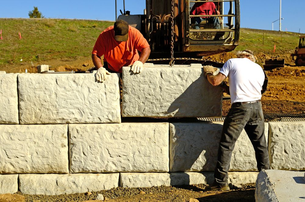 workers building a retaining wall