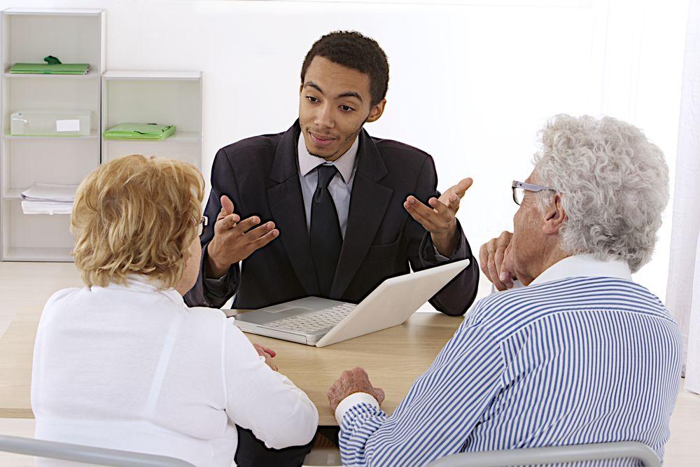 insurance salesman talking to customers