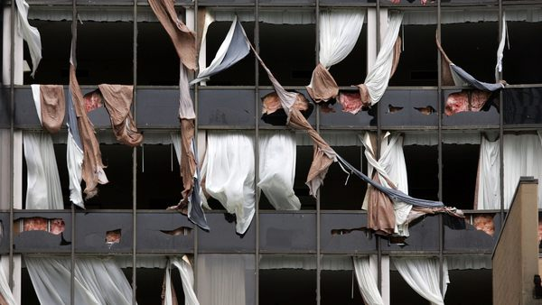 The North side of the Hyatt hotel in New Orleans was shredded by 140 mph winds when Hurricane Katrina made landfall on the Louisiana coast on Monday, August 29, 2005. (AP Photo/Dave Martin)