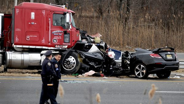 A head on collision between a tractor-trailer and an automobile carrying 3 Linden police officers and a civilian employee, killing two and leaving two others in critical condition. The car was traveling in the wrong direction on the southbound West Shore Expressway at about 5 a.m. when the crash occurred in Staten Island, New York City on March 20, 2015. Credit: Dennis Van Tine/MediaPunch/IPX