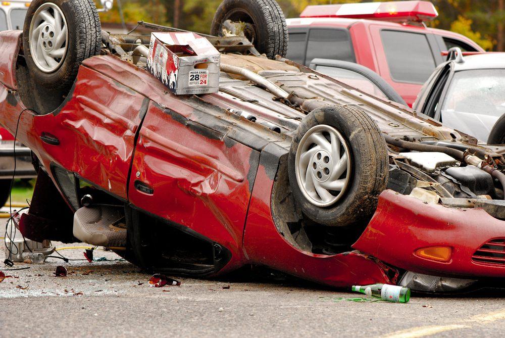 red overturned car