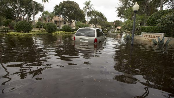 Flood waters filled the streets in the Meadows section of Boynton Beach, Fla., Friday, Jan. 10, 2014, trapping cars. Boynton Beach got nearly two feet of rain in a 24-hour period. (AP Photo/J Pat Carter)