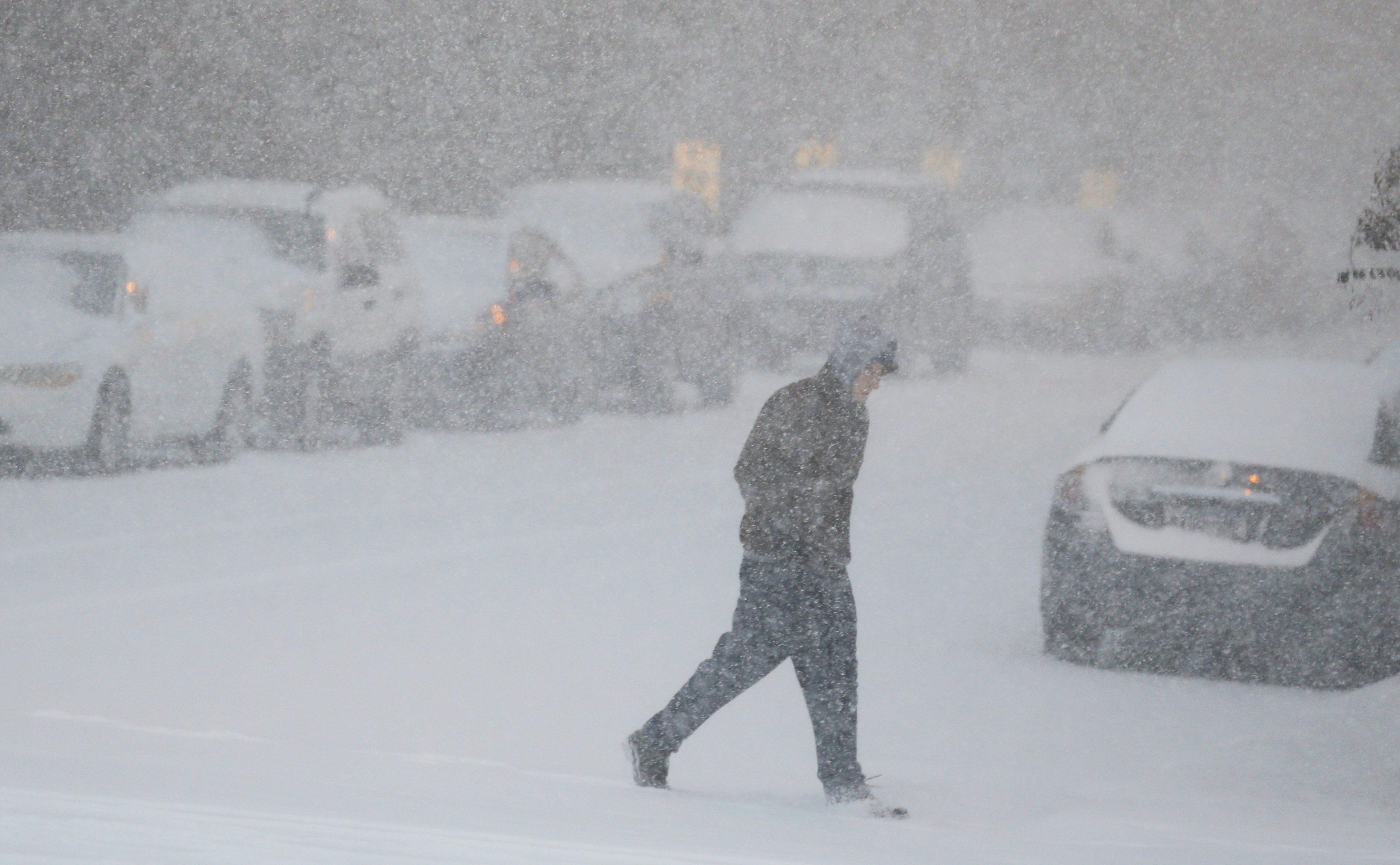 A pedestrian crosses the street near the Country Club Plaza shopping district Kansas City, Mo., Thursday, Feb. 21, 2013.