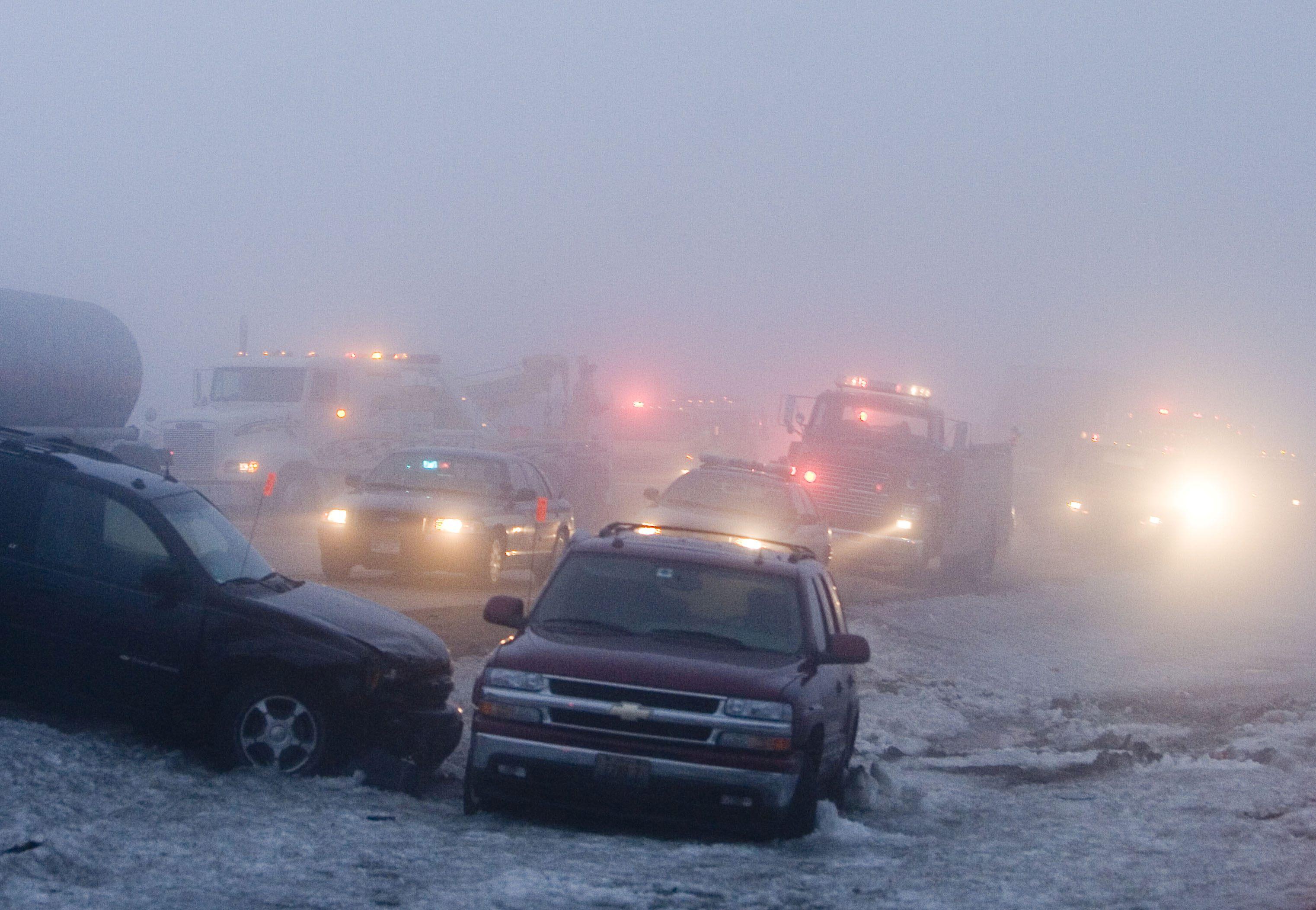 Emergency personnel make their way to multi-car pileup on Interstate 90 near Madison, Wis., Sunday, Jan. 6, 2008.
