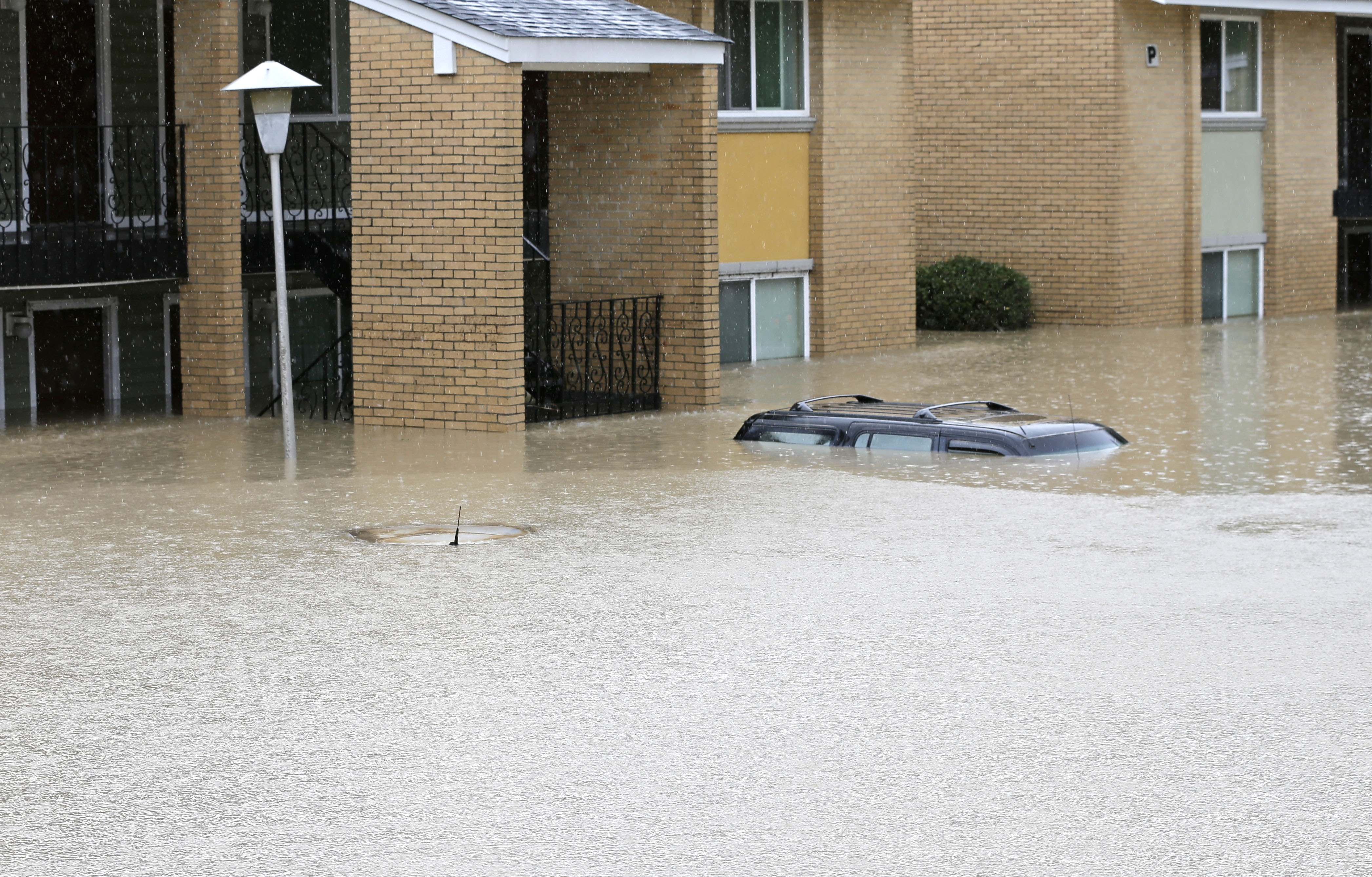 Flood waters engulf cars at an apartment complex in Columbia, S.C., Sunday, Oct. 4, 2015.