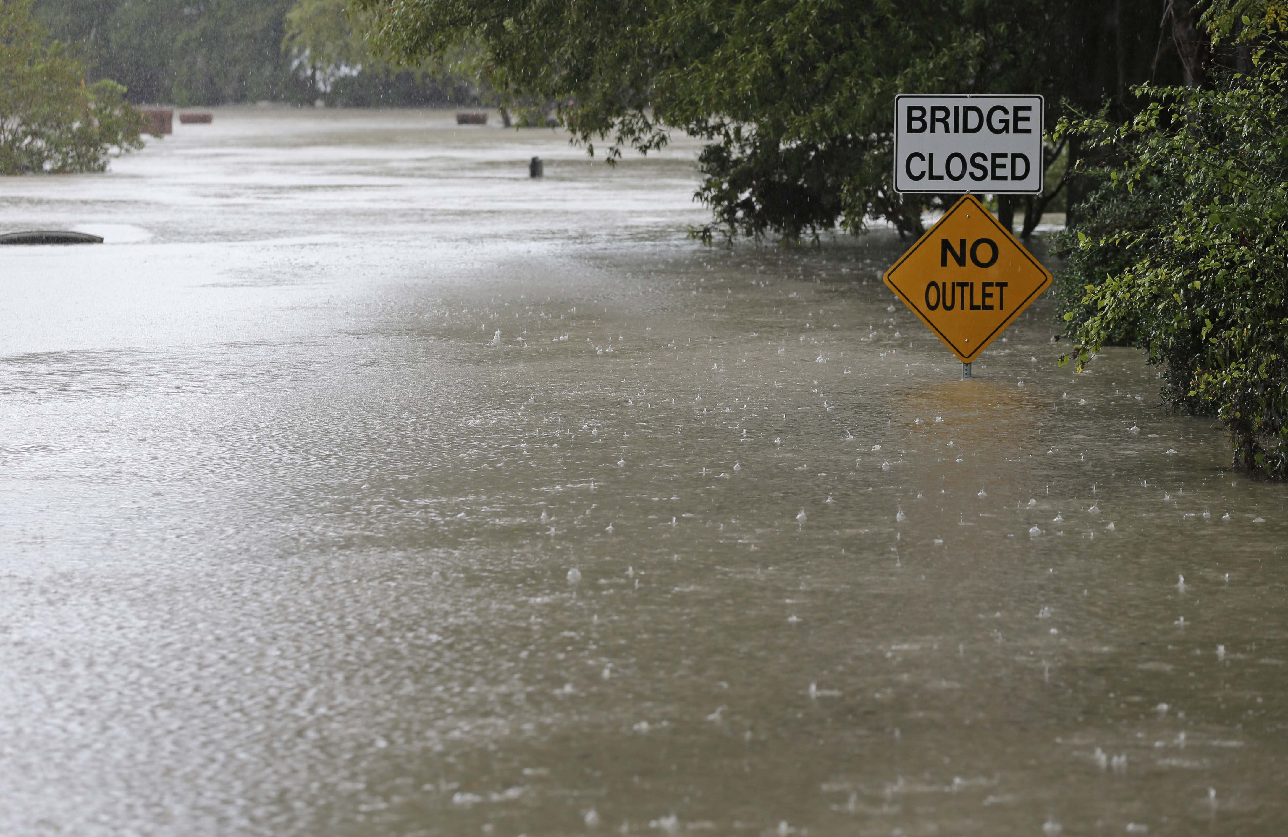 Floodwaters cover a road in Columbia, S.C., Sunday, Oct. 4, 2015.