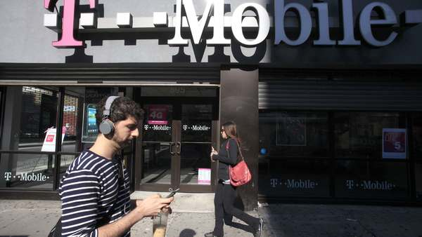 Credit reporting agency Experian on Thursday, Oct. 1, 2015 said that hackers accessed the social security numbers, birthdates and other personal information belonging to about 15 million T-Mobile wireless customers. T-Mobile uses Experian to check the credit of its customers. (AP Photo/Mark Lennihan, File)