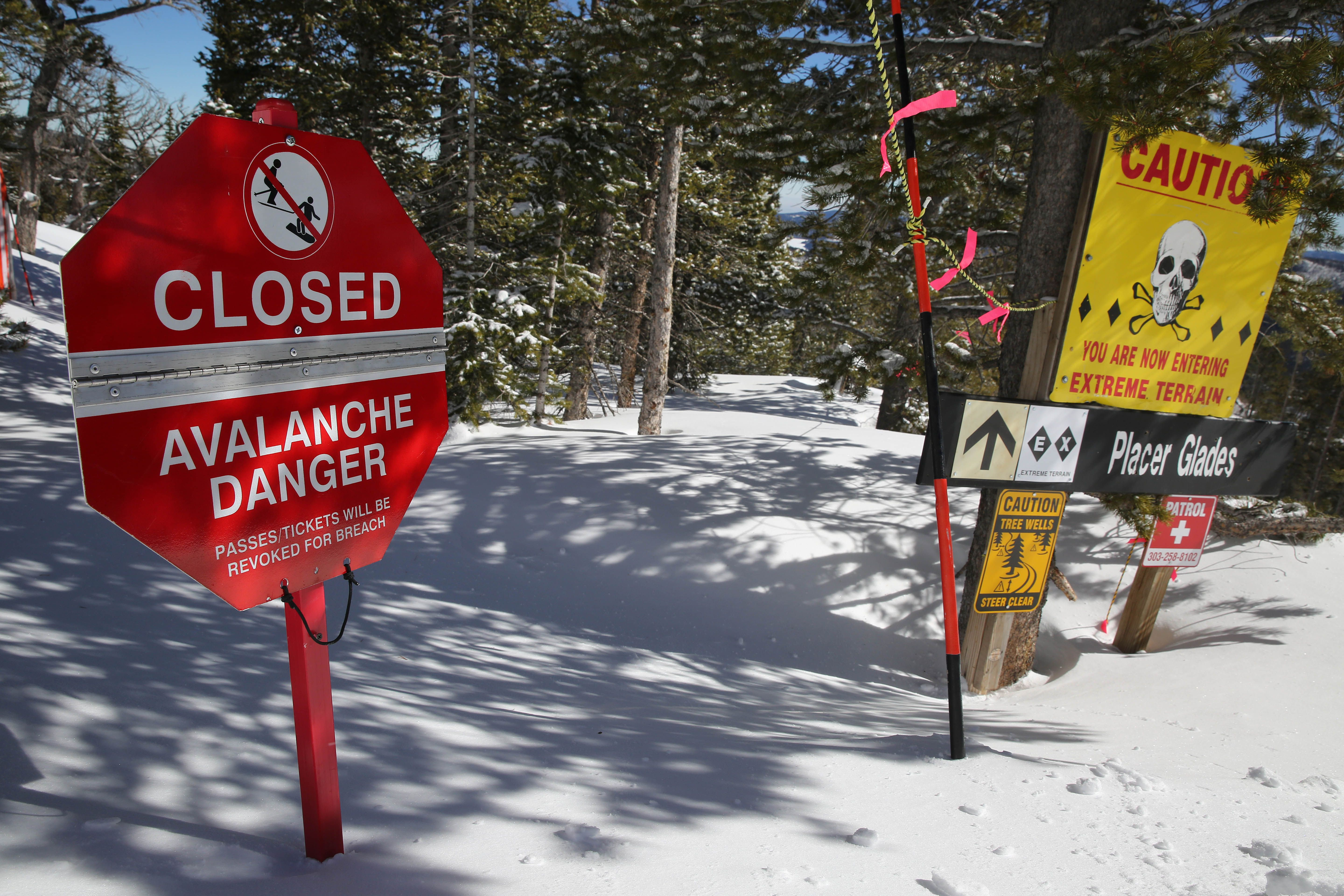 An avalanche danger sign closes off a specific area of the woods due to avalanche risk, on Corona Bowl, known for its extreme skiing, at Eldora Mountain Resort, near Nederland, Colo., Wednesday, Feb. 26, 2014.