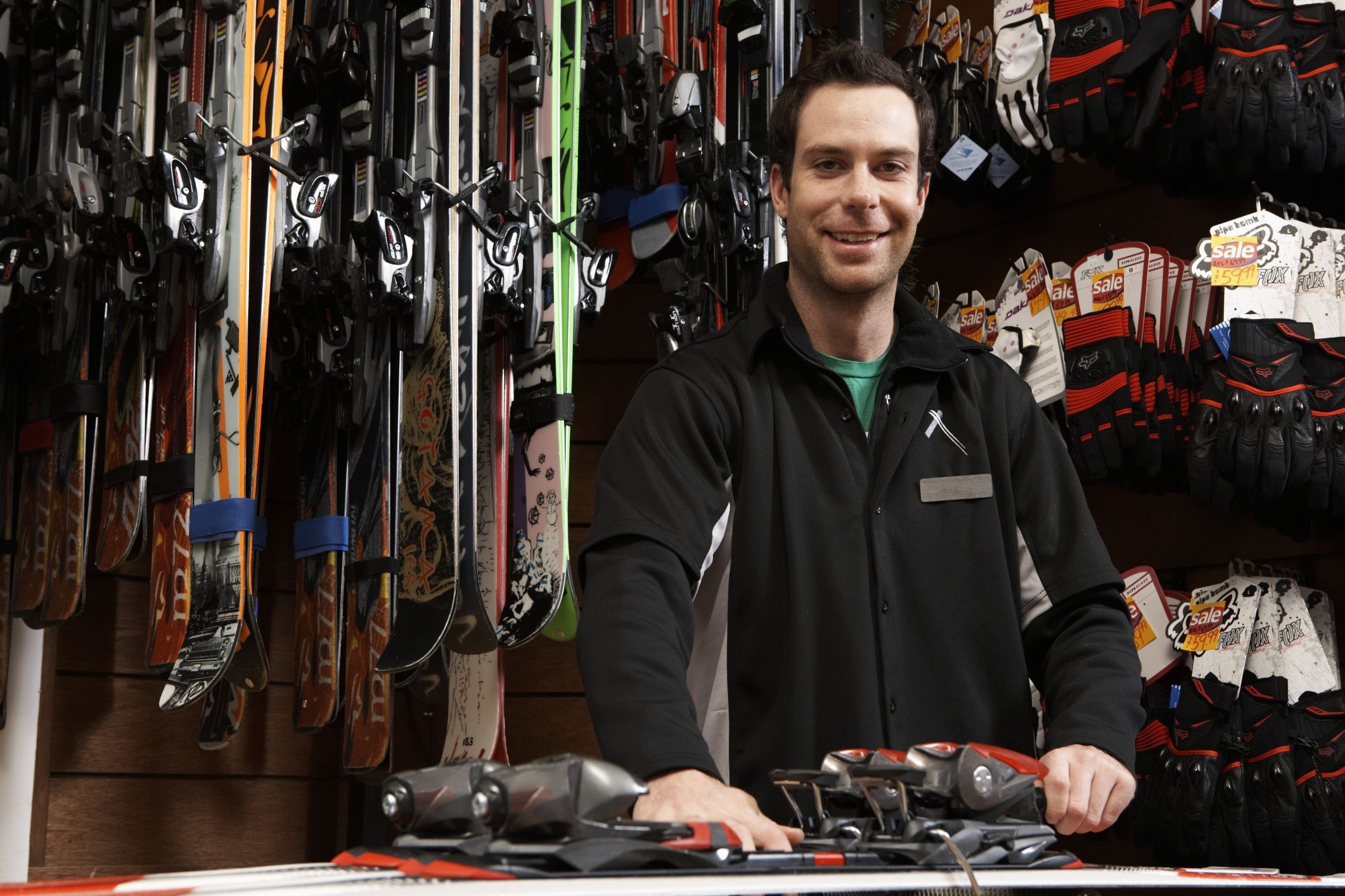 Man checking skis and bindings in a shop