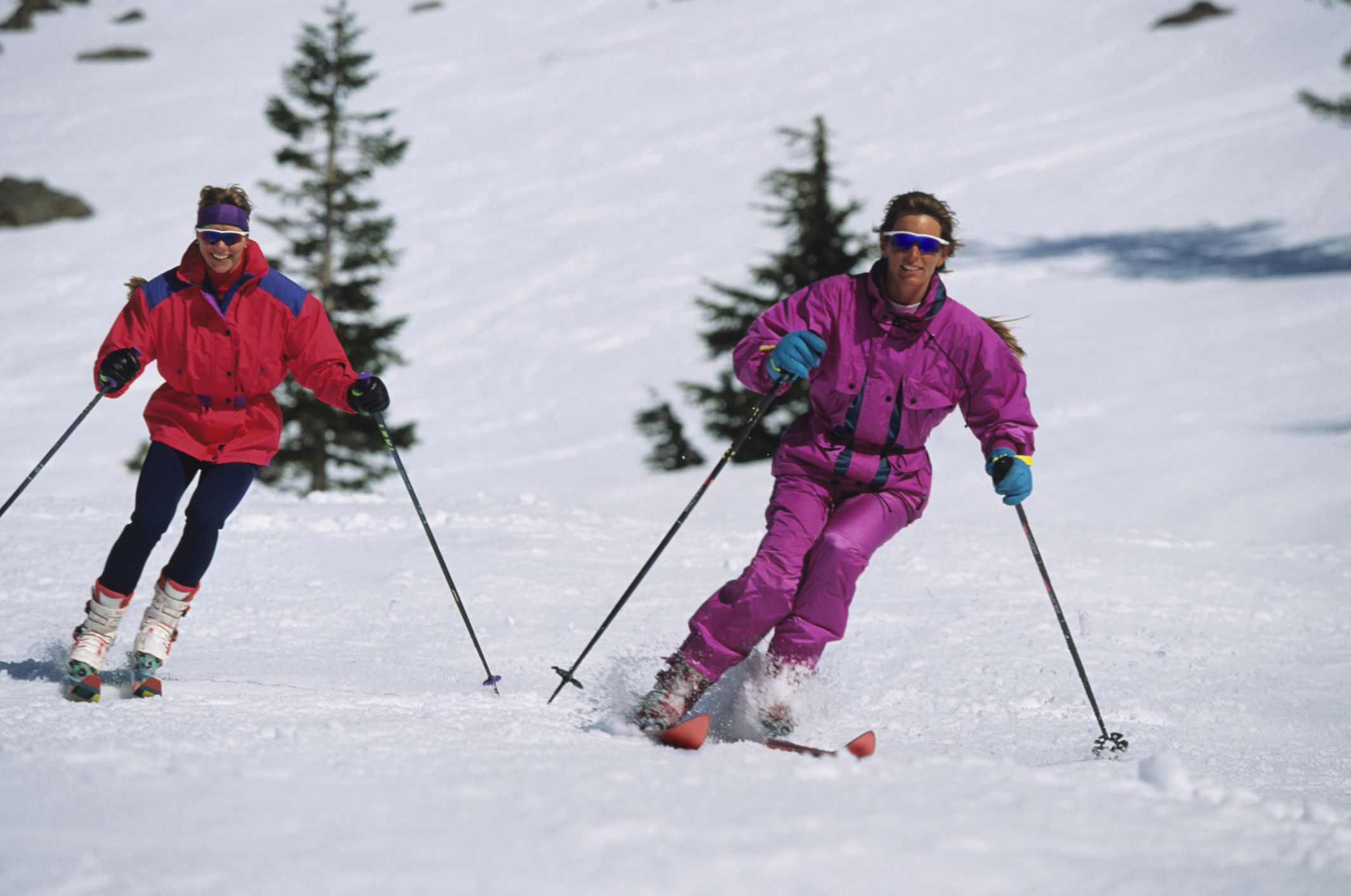 pair of female skiers