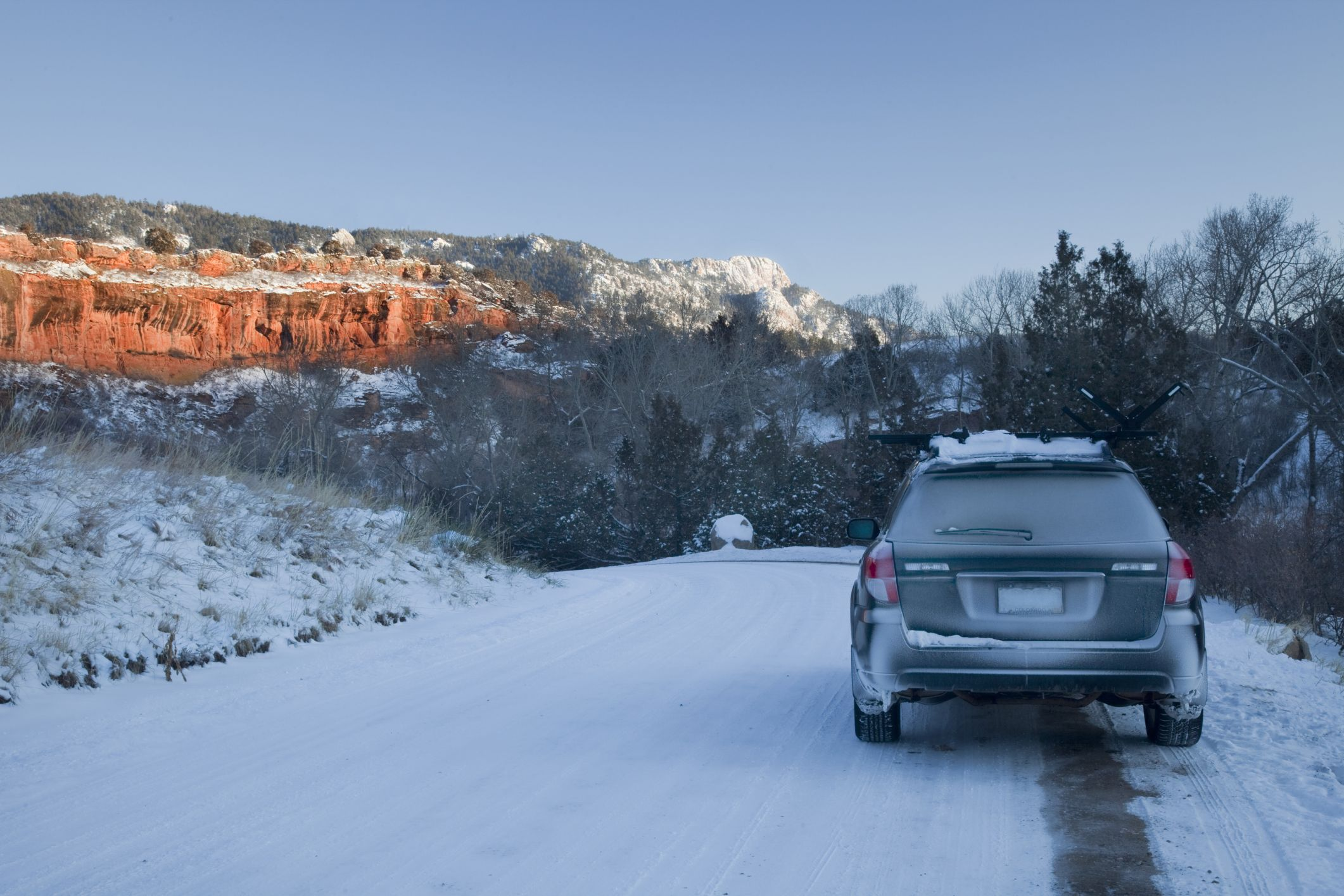 car driving in snow in Colorado mountains