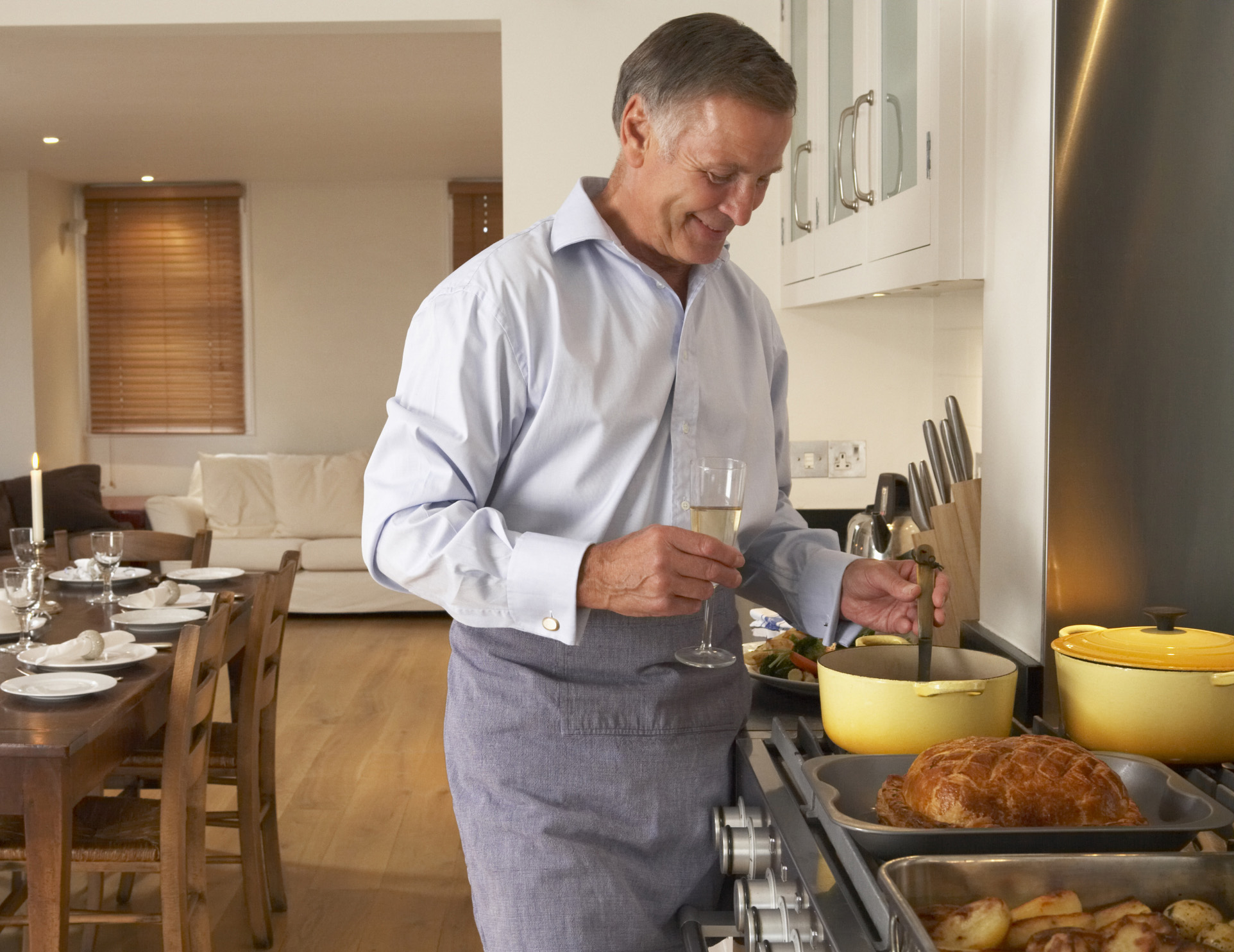 Older-man-cooking-drinking-wine-crop-ThinkstockPhotos-100566054-Cathy Yeulet