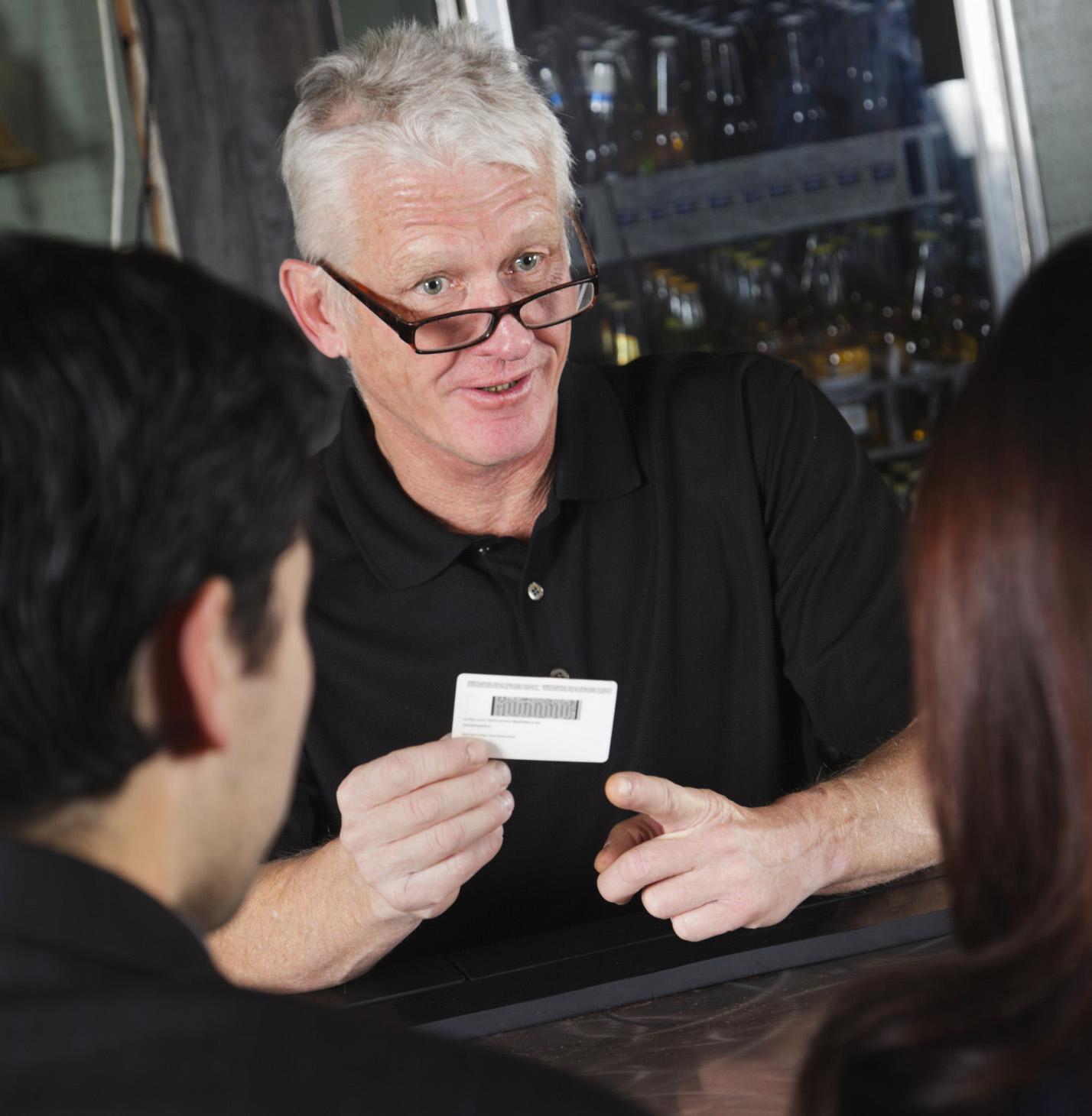 Bartender-checking-IDs-crop-ThinkstockPhotos-185007448-Rich Legg