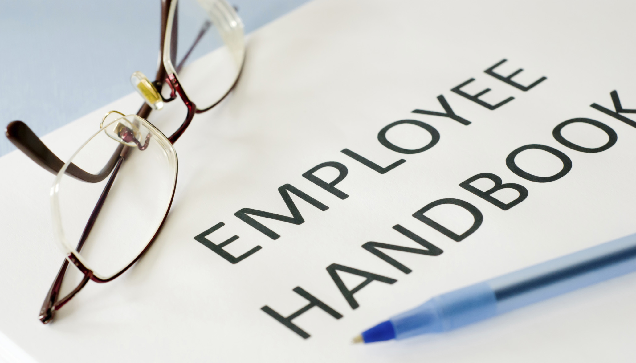 White-background-employee-handbook-black-print-pen-glasses-crop-ThinkstockPhotos-179246136-c-George
