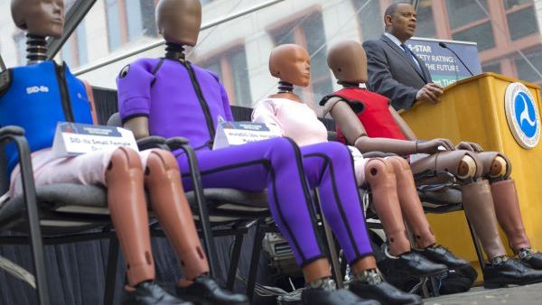 Transportation Secretary Anthony Foxx, with new crash test dummies called 'THOR', during the announcement for plans to update its safety rating system for new cars to include whether the car has technology to avoid crashes, in addition to how well it protects occupants in accidents in Washington, Tuesday, Dec. 8, 2015. (AP Photo/Pablo Martinez Monsivais)