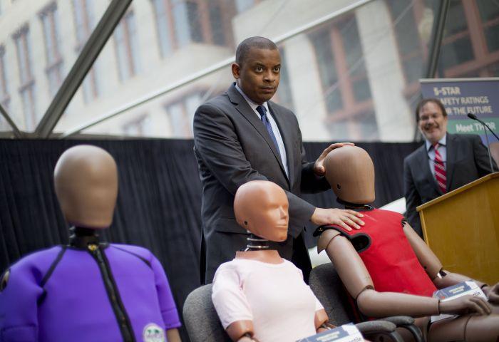 Transportation Secretary Anthony Foxx with new crash test dummies called 'THOR'