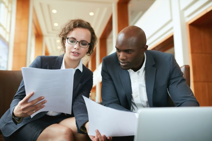 Man and woman reviewing sales leads