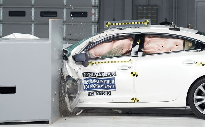 Action shot taken during the 2016 Mazda 6 small overlap frontal crash test.