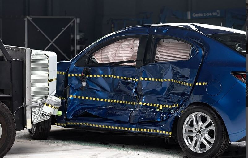 View of the Scion iA and barrier just after the side impact crash test