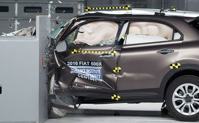 Action shot taken during the small overlap frontal crash test of the 2016 Fiat 500X