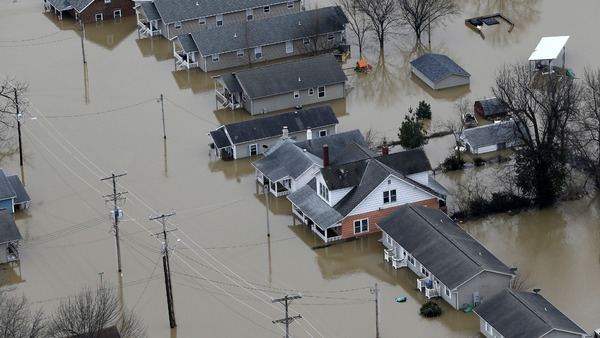 In this aerial photo, homes are surrounded by floodwater, Wednesday, Dec. 30, 2015, in Pacific, Mo. A rare winter flood threatened nearly two dozen federal levees in Missouri and Illinois at the end of December as rivers rose, prompting evacuations in several places. (Photo: Jeff Roberson/AP Photo)