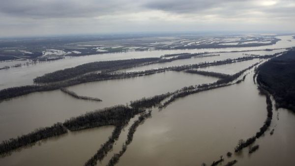 In this aerial photo, the Mississippi River spills out of its banks, Thursday, Dec. 31, 2015, near Ste. Genevieve, Mo.  (AP Photo/Jeff Roberson)
