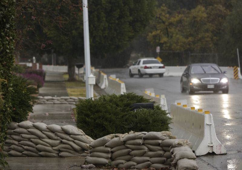 Concrete barriers are set to protect homes from flash flooding in Glendora, Calif., on Tuesday, Jan. 5, 2016.