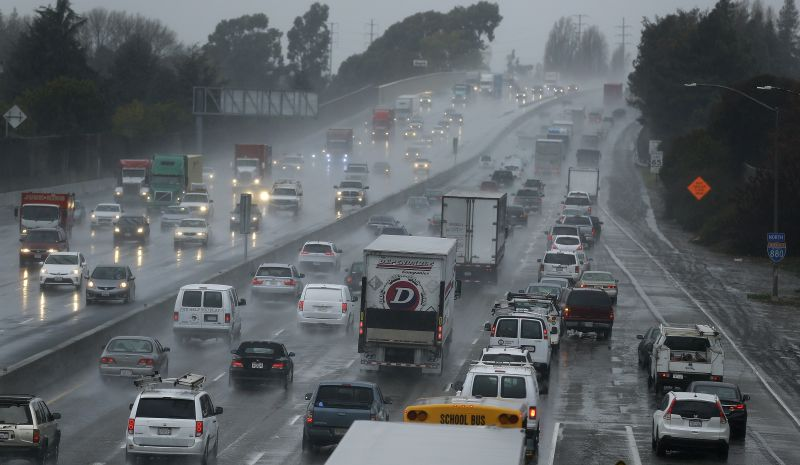 Vehicles slow on Interstate 80 during a winter rain storm Tuesday, Jan 5, 2016, in San Leandro, Calif.
