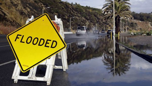 A sign warning of flooded road is posted along the Pacific Coat Highway in Malibu, Calif. after a heavy rain on Tuesday, Jan. 5, 2016. Californians were warned against abandoning conservation efforts Tuesday as several weeks of storms spawned by El Niño began hitting the West Coast. Heavy rain and snow are welcome after four years of drought in California, despite their potential for causing flash floods and mudslides. (Photo: Nick Ut/AP Photo)