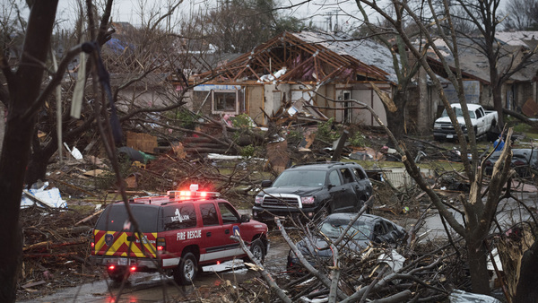 An emergency vehicle drives through a neighborhood in Rowlett, Texas, Sunday, Dec. 27, 2015, the morning after it was struck by a tornado. At least 11 people died and dozens were injured in apparently strong tornadoes that swept through the Dallas area and caused substantial damage this weekend.(Photo: Rex C. Curry/AP Photo)