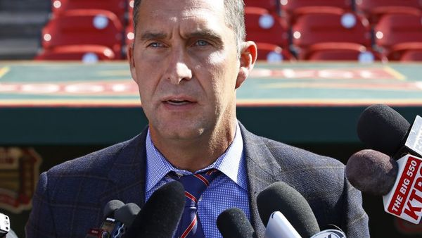 In this Monday, April 27, 2015 file photo, St. Louis Cardinals General Manager John Mozeliak addresses members of the media prior to a baseball game against the Philadelphia Phillies, in St. Louis. The St. Louis Cardinals say they have fired scouting director Chris Correa, Thursday, July 2, 2015. The Cardinals declined to say why, but the team is the subject of an FBI investigation into the hacking of the Houston Astros player personnel database. (AP Photo/Billy Hurst, File)