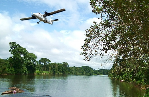 Blue-wings-airlines-small-plane-flying-over-river-from-website