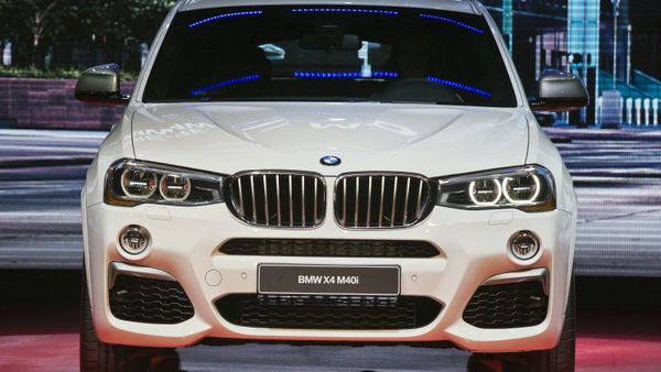 The front end grill of a new BMW X4 M40i SUV is on display at the North American International Auto Show, Monday, Jan. 11, 2016, in Detroit, Mich. (AP Photo/Tony Ding)