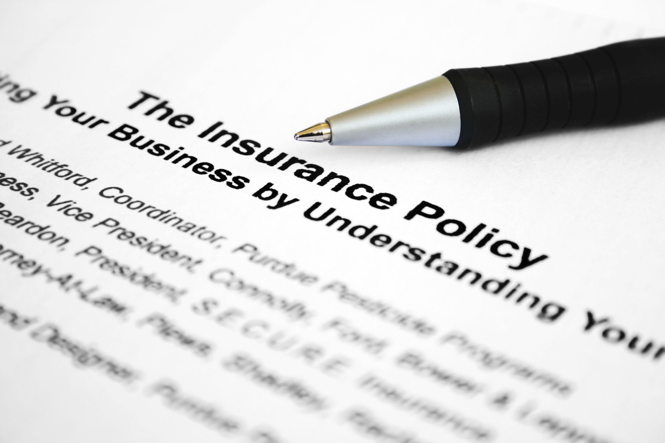 Insurance policy and writing pen