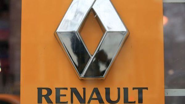 The Renault logo is pictured on a Renault showroom, in Paris, Tuesday, Jan. 19, 2016. France's environment minister says Renault will recall 15,800 cars to update their emissions filters, saying the current filters were inadequate in warm weather. (AP Photo/Thibault Camus)