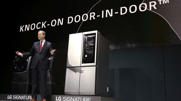 David VanderWaal, vice president of marketing for LG Electronics USA, demonstrates the new LG SIGNATURE refrigerator's Knock-On Door-in-Door technology, which becomes transparent so users can check the contents of the refrigerator without opening the door, during the LG press conference at CES 2016, Tuesday, Jan. 5, 2016, in Las Vegas. (Jack Dempsey/ AP Images for LG Electronics)