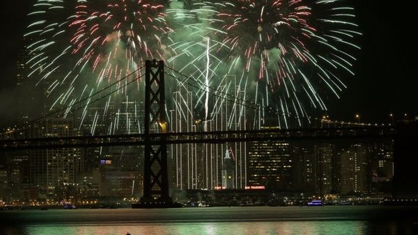 Fireworks light up the sky over the San Francisco-Oakland Bay Bridge for New Year's. The San Francisco area came second in the Milken Institute's ranking of cities for economic growth. (Photo: Marcio Jose Sanchez/AP Photo)