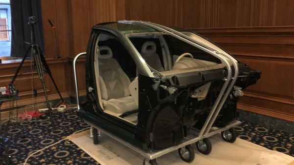 This Jan. 8, 2016 photo provided by the U.S. District Court, Southern District, taken by a court employee/photographer, shows a section of a General Motors car in a courtroom in New York where jury selection began Monday, Jan 11, 2016, for a trial meant to narrow legal issues for hundreds of civil lawsuits brought against General Motors over faulty ignition switches. (U.S. District Court, Southern District via AP)