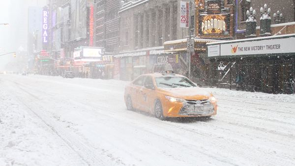 A taxicab drives through a largely empty Times Square in New York City, Saturday, Jan. 23, 2016. A blizzard with hurricane-force winds brought much of the East Coast to a standstill, dumping as much as 3 feet of snow, stranding tens of thousands of travelers and shutting down the nation's capital and its largest city. (Photo: Rainmaker Photo/MediaPunch/IPX via AP Photo)