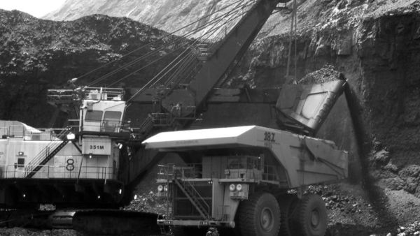 In this April 2007 file photo, a shovel prepares to dump a load of coal into a 320-ton truck at the Black Thunder Mine in Wright, Wyo. (AP Photo/Matthew Brown, File)