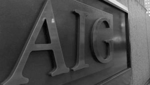 The AIG logo is seen on the side of building in Tokyo, Japan. (AP Photo/Shizuo Kambayashi, File)