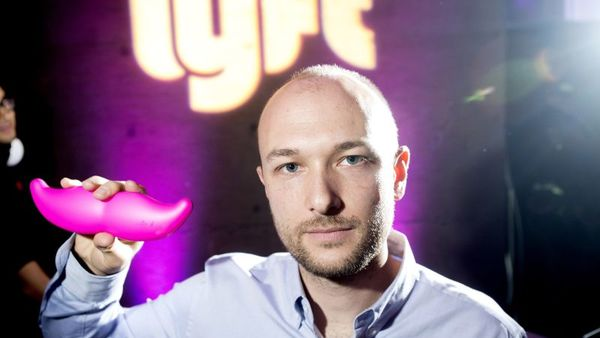 In this Monday, Jan. 26, 2015, file photo, Logan Green, co-founder and chief executive officer of Lyft, displays his company's