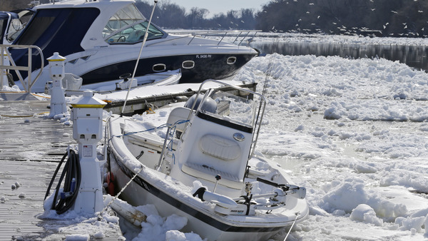 Boats are trapped in ice that clogs the James River as it flows past downtown Richmond, Va., Monday, Jan. 25, 2016. (Photo: Steve Helber/AP Photo)