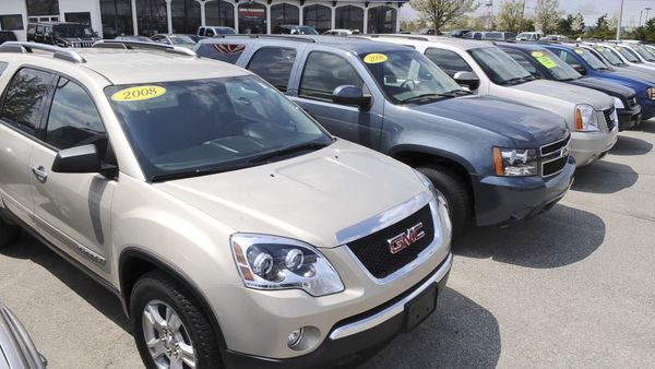 Auto dealers aren't required by law to fix safety defects before selling a car. (AP Photo/Lisa Poole)