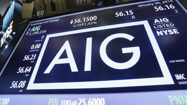 The AIG logo is shown above the post where it trades, on the floor of the New York Stock Exchange, Tuesday, Jan. 26, 2016. Insurer AIG is selling its broker-dealer segment, starting an initial public offering for its mortgage-insurance division and slashing expenses after coming under pressure from activist investor Carl Icahn. (AP Photo/Richard Drew)